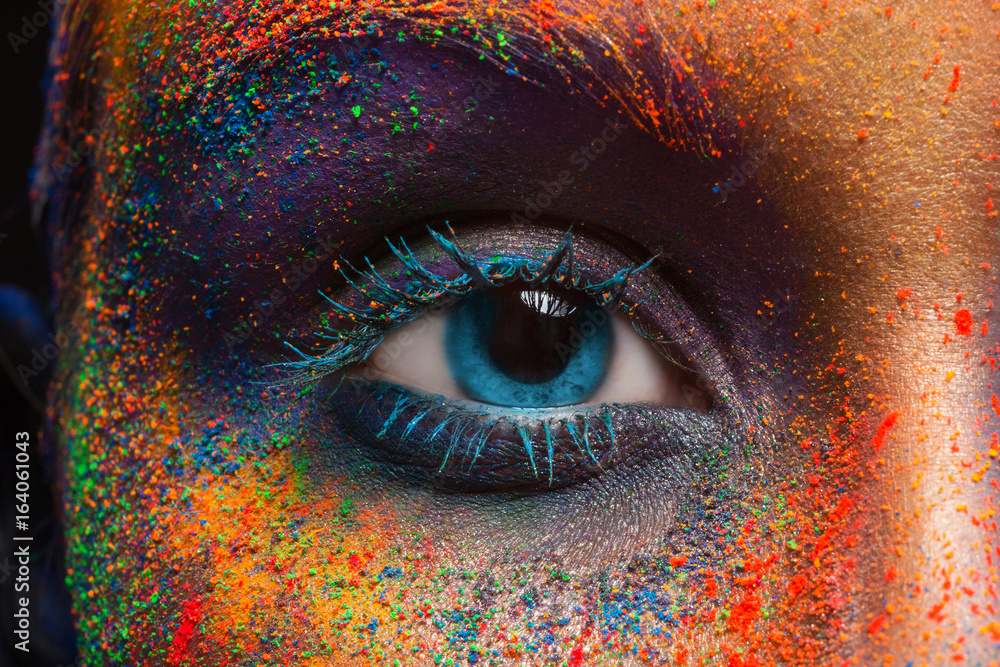 Fototapeta Eye of model with colorful art make-up, close-up