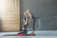 Young Woman With Yoga Instructor In Fitness Club, Gomukhasana