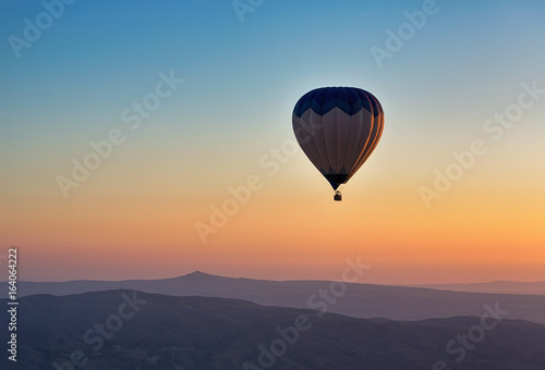 Fotobehang Ballon Hot air balloon flight at sunrise.