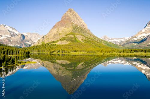 Fotografia, Obraz  Early Morning Reflection on Swiftcurrent Lake in Glacier National Park, Montana