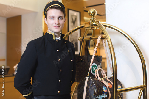 Vászonkép Young man in uniform serving in hotel