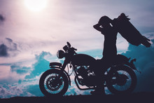 Silhouette Of Biker Man With H...