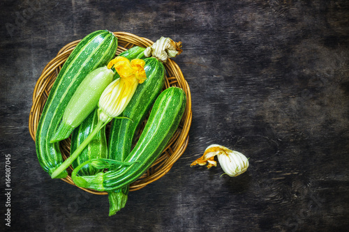 Fresh zucchini on the dark background