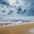 seascape image of stormy day on beach