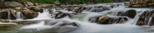 background landscape with waterfall in Yaremche vilage in Ukraine