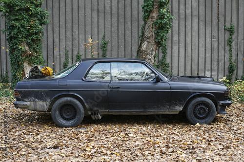 German Mercedes Benz motor car W123 E-class parked on abandoned factory yard Wallpaper Mural