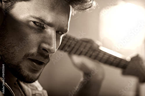 Valokuva  Closeup portrait of a handsome musician