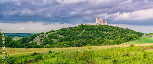 Fotografie, Tablou The ruins of the medieval castle of Csesznek sitting on a rock, Western Hungary
