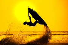 Man Drive Freestyle Jet Ski At Sunset.