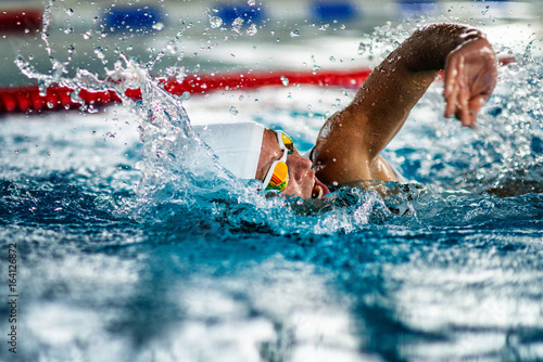 Female swimmer on training in the swimming pool Canvas Print