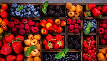 Various Fresh Summer Berries On The Gray Background.Food Or Healthy Diet Concept.Super Food.Vegetarian.Top View.selective Focus.