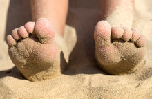 Child Feet Covered With Sand On The Beach, Detail