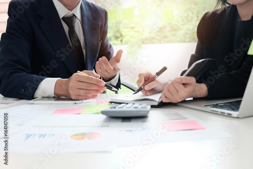 Fotomural Financial planning Business man and Business woman talking to planner financial business, report finance in paper on office accounting desk