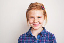 Portrait Of Happy Redhead Little Girl Smiling.