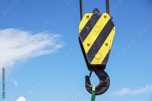 Big yellow construction crane on blue sky background фототапет