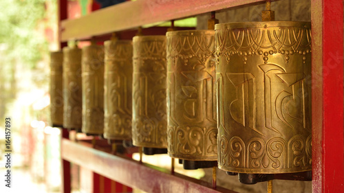 Photo  Buddhist Praying Wheels at Norbulingka Institute