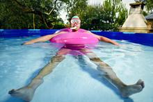 Man Swimming In A Portable Swi...