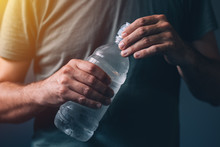 Man With Bottle Of Fresh Drinking Water