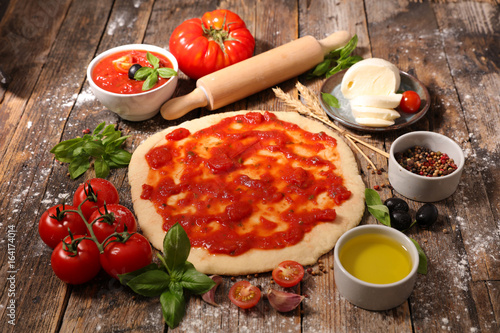 cooking pizza with tomato sauce,mozzarella and basil Canvas-taulu