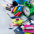 Assortment of school supplies, crayons, pens, chalks