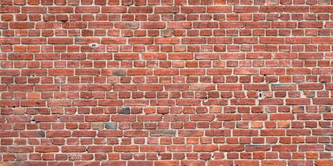 Rote Mauer aus Backstein als Hintergrund