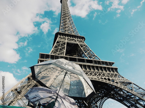 Deurstickers Eiffeltoren Low Angle View Of Umbrellas By Eiffel Tower Against Sky