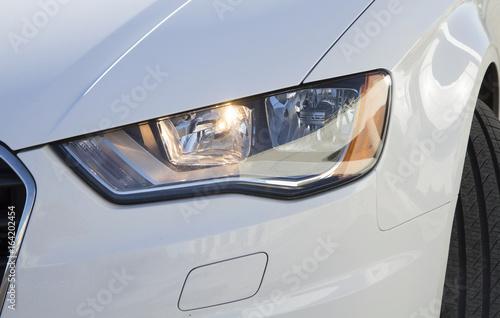 Fototapeta White car headlight close up, beam obraz na płótnie
