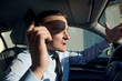 businessman in car with phone