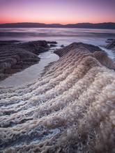 Sunrise Over The Dead Sea With Salt Crystals