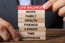 Businessman Building Life Balance Concept With Wooden Blocks