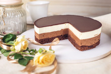 Chocolate Cake Made Of Three Different Chocolate Mousse Layers , White , Milk And Dark With Chocolate