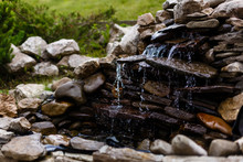 Artificial Waterfall . Decorations In The Garden.
