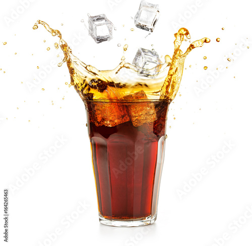 ice cubes falling into a cola drink splashing