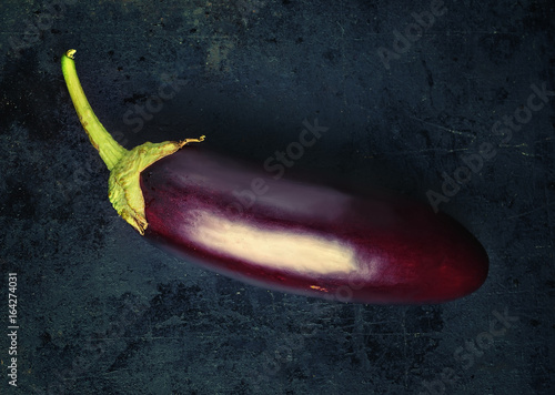 Eggplant on a dark background. Focus concept.