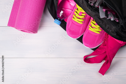 0312a265c5 Pink set in a sports bag on a gray board background - Buy this stock ...