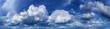 Leinwandbild Motiv Panorama of the blue sky with clouds