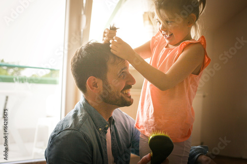 Father and daughter spending funny time at home.