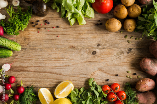 Cadres-photo bureau Cuisine Fresh farm market vegetables, organic fruits and greens on rustic wooden background. Top view with copy space