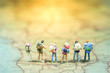 canvas print picture - Selective focus. Miniature people : small traveler figures with backpack standing on South Africa Map / Geography of South Africa, exploring on earth background concept.
