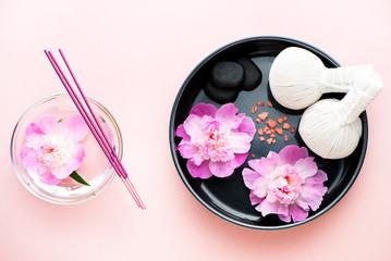 Obraz na płótnie Canvas Spa. Herbal massage balls, flowers, black stones, incense and sea salt