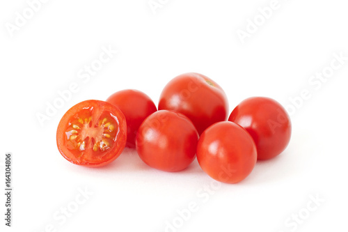 Fototapeta Some fresh cherry tomatoes isolated on white background obraz
