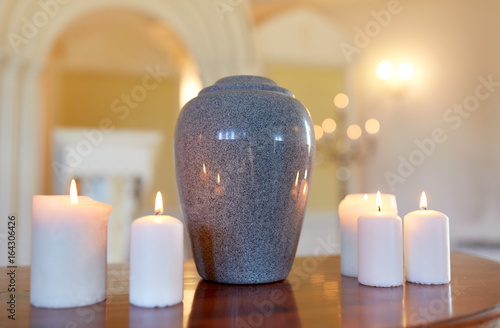 cremation urn and candles burning in church Canvas