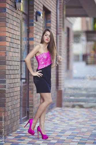 Beautiful Sexy Girl In Short Pink Black Dress On High Heels A Young