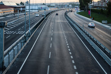 Asphalt Highway On Bosporus With Three Lanes And Cars Passing By. With Street Lights. Picture Taken From The Bridge