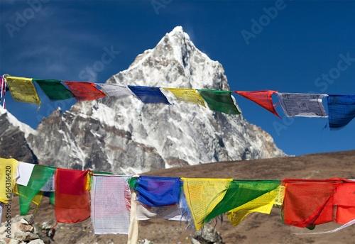 Photo  Rows of prayer flags and mount Arakam Tse