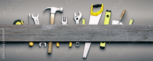 Valokuvatapetti Hand tools on grey wooden background. 3d illustration