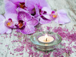 Candle with orchids