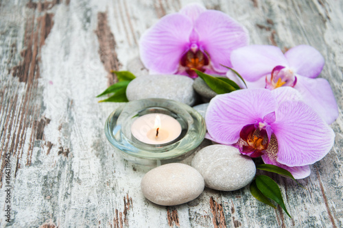 Keuken foto achterwand Spa Candle with orchids