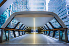 London, England - Public Pedestrian Cross Rail Footbridge At The Financial District Of Canary Wharf With Skyscrapers