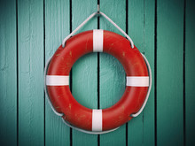 Life Belt Or Rescue Ring  On Wooden Wall. Salvation, Protection And Security Concept.
